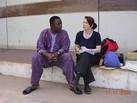 Picture 3: A conversation between a counsellor and a man after his return to his homeland in Africa